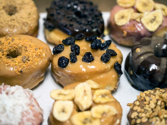 An assortment of toppings from Hi-Five Doughnuts.
