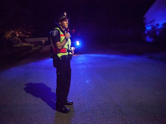 Staunton police officer Corey Wood stands at the scene of a reported shooting in the 800 block of Cherry Hill Drive on Wednesday, Sept. 30, 2015.