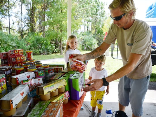 Giving Back: Child Collects Food for the Childrens Hunger Project