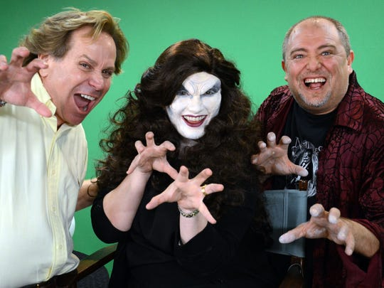 Ray Asiala and Alan Ostrander of AEO Studios apply makeup and hair to Christina LaFortune. They are designing the characters for this year's Trail of Terror at Brevard Zoo.