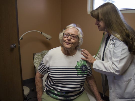 Margaret Voss takes a deep breath in and holds it during her checkup with nurse Teresa Smith, FNP, at the Benefis Teton Medical Center in Choteau.