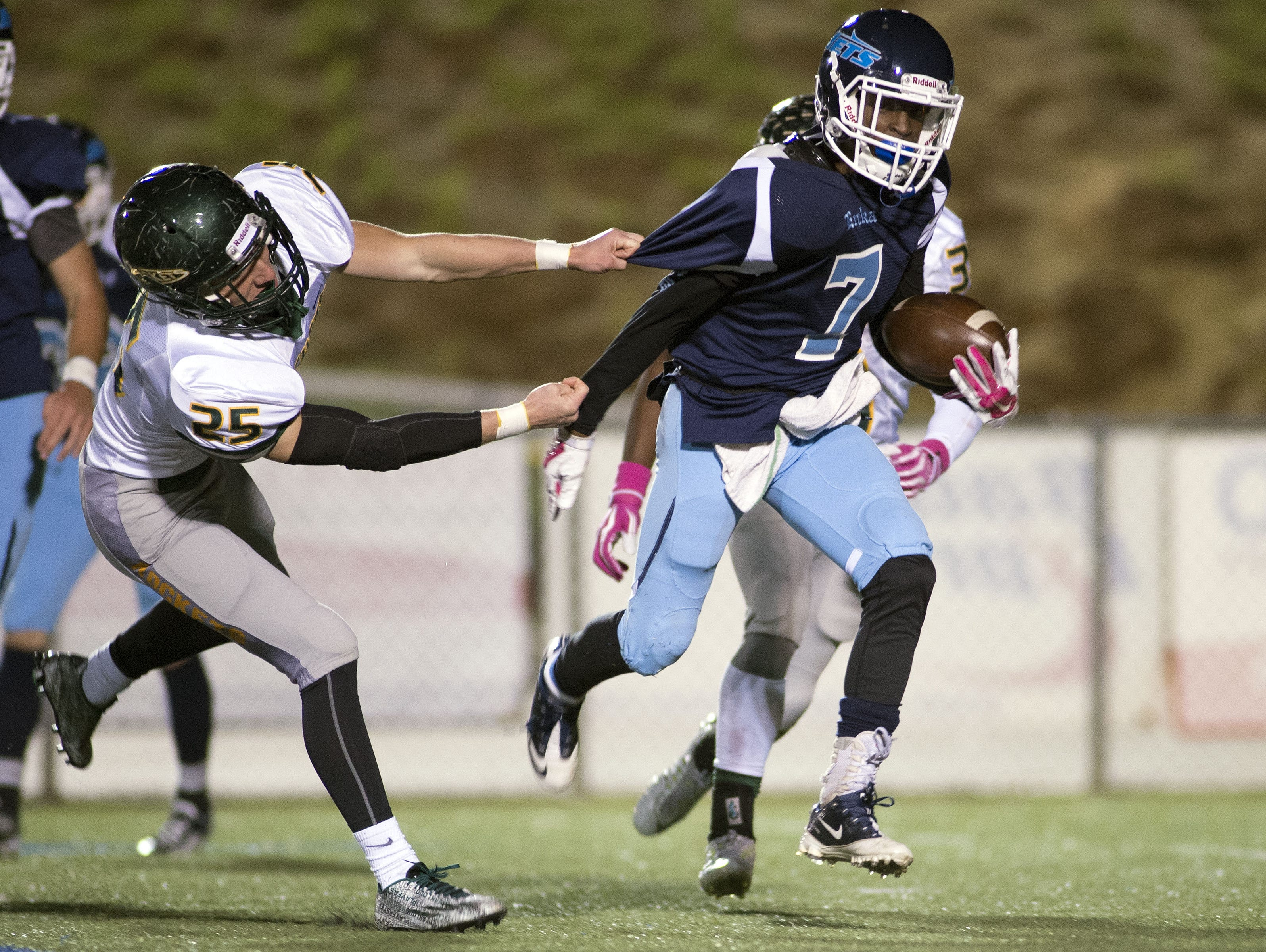 Sayquan Bethea carries the ball Friday night for Enka.