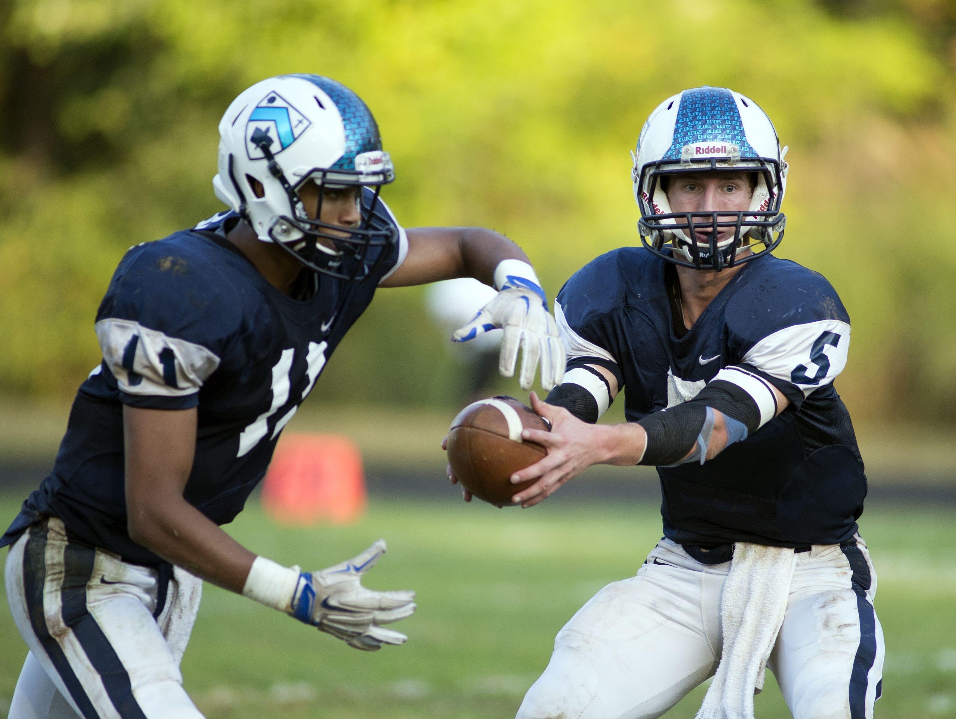 Asheville School quarterback David Schill (5).