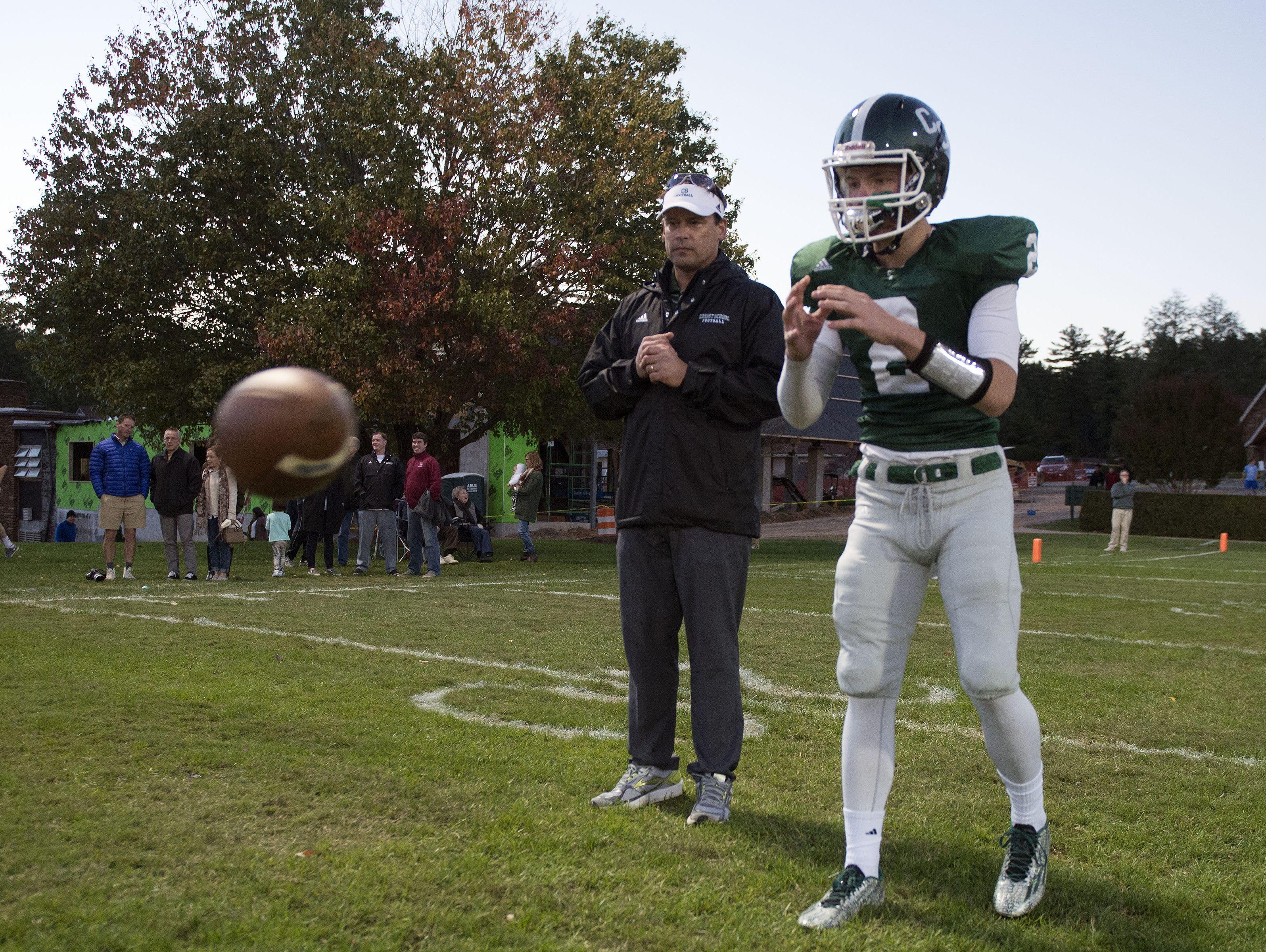 Christ School quarterback Drew Johnson and Greenies assistant coach Heath Shuler.