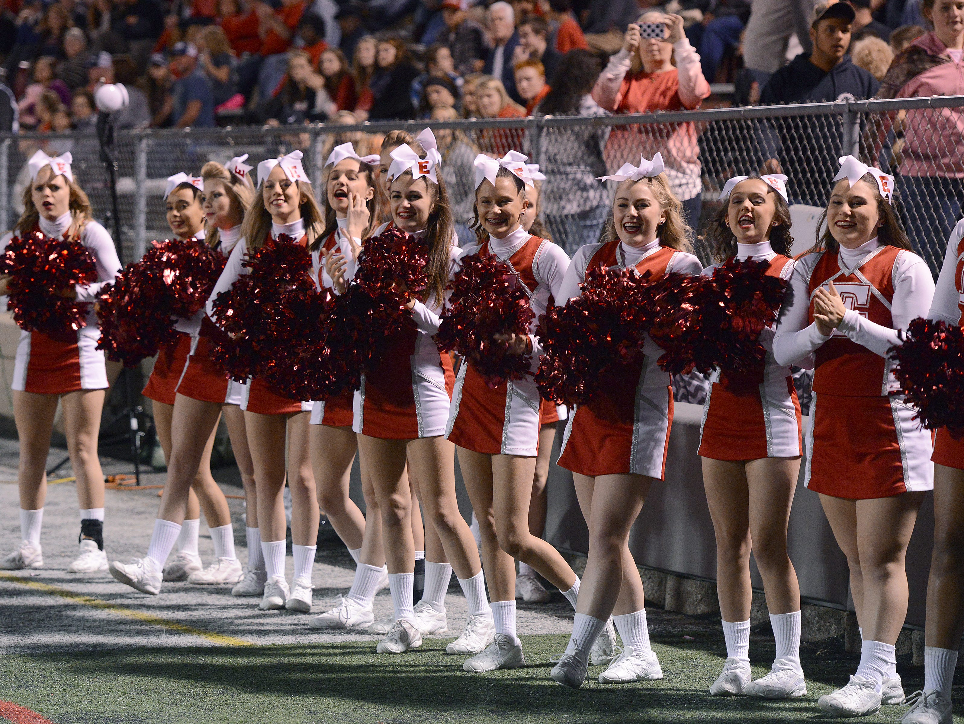 Erwin cheerleaders pull for their team during Friday's home game against North Buncombe.