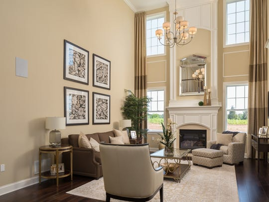 This two-story family room at Gateway at Royce Brook's