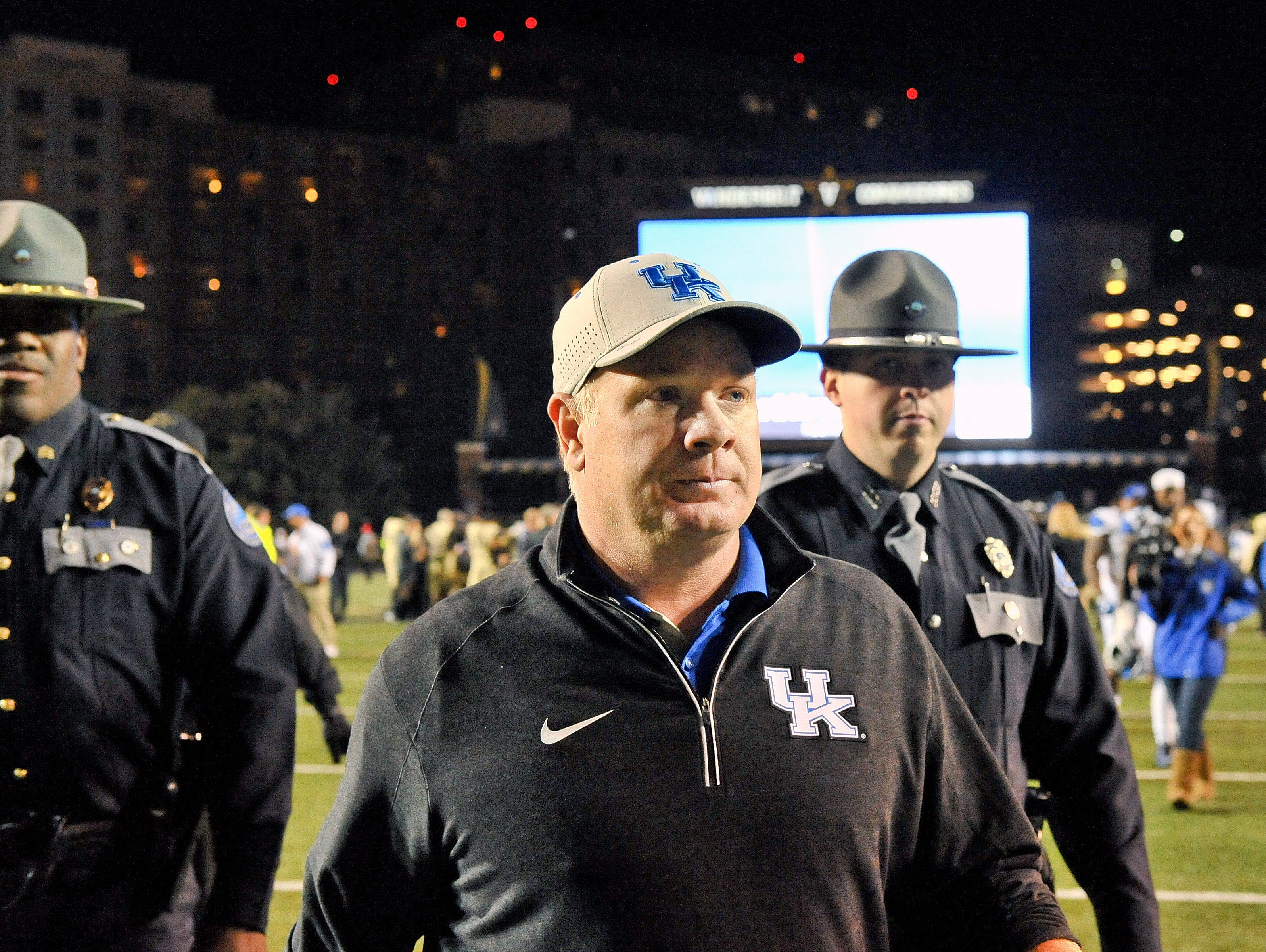 Nov 14, 2015; Nashville, TN, USA; Kentucky Wildcats head coach Mark Stoops walks off the field after his team is defeated by the Vanderbilt Commodores during the second half at Vanderbilt Stadium. Vanderbilt won 21-17.