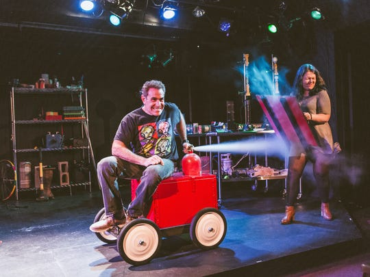 "David Maiullo and his assistant, Kelsey Lane Dies, demonstrate properties of physics during ""That Physics Show,"" an off-Broadway science revue.  Maiullo honed his skills as a presenter in his job as physics support specialist at Rutgers University in Piscataway."