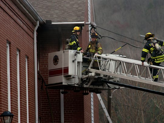 Asheville Fire Department firefighters work to contain