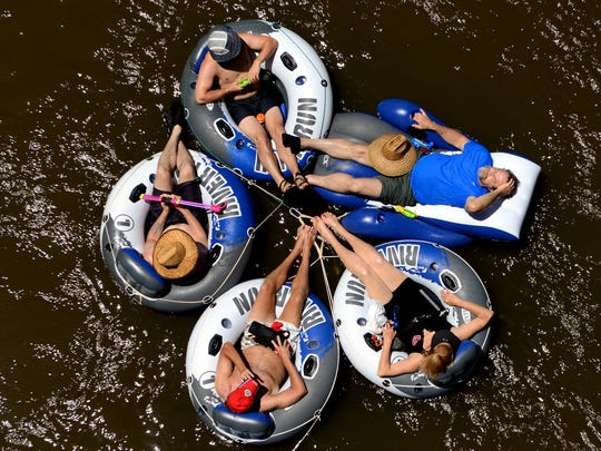 Thousands of people enjoy tubing down the French Broad River every summer.