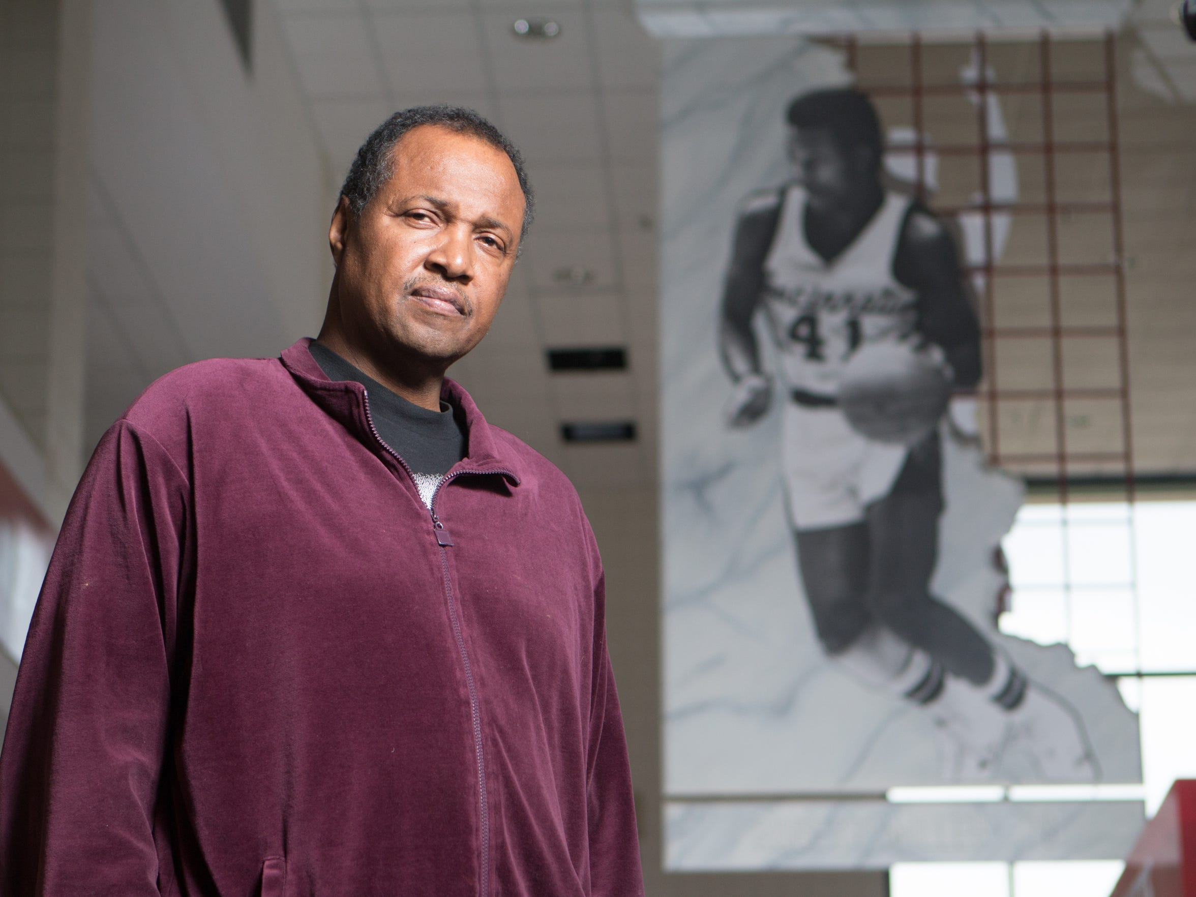 Louisville native Robert Miller played college basketball at the University of Cincinnati. He was there under head coach Gale Catlett from 1975-1978. He is pictured in the Shoemaker Ceneter on the UC campus. A photograph of him and his number 41 jersey hangs in the center with other UC greats.