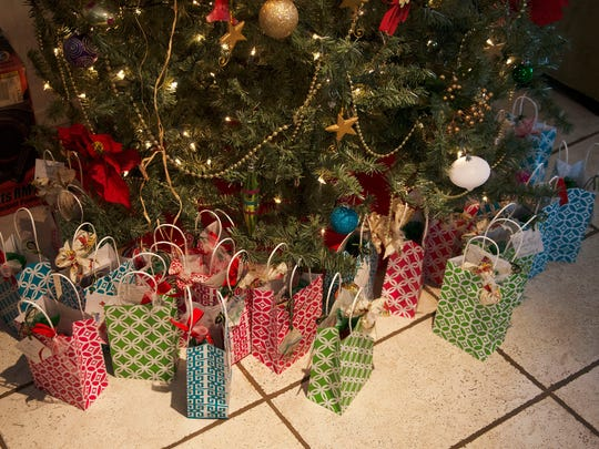 Christmas gifts sit ready to open at the Steadfast House during Christmas Day festivities Friday.