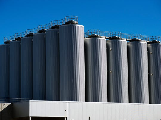Brewing tanks rise high above the New Belgium brewery, under construction next to the French Broad River in Asheville Thursday Jan. 7, 2016.