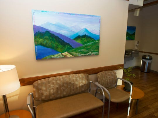 Artwork from a former homeless patient brightens the waiting room of the Dale Fell Health Center located at at 7 McDowell Street Asheville. The clinic is set to open Feb. 8.