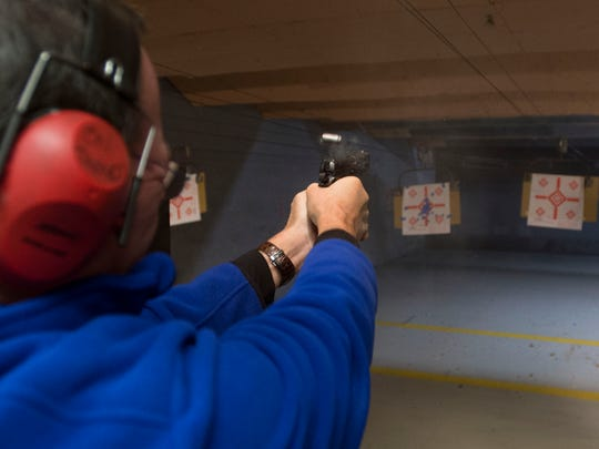 Al Aldecoa fires his 45-caliber pistol at a target at On Target Shooting Range Inc. Thursday morning. Aldecoa has a concealed carry permit which allows him to carry a handgun legally.