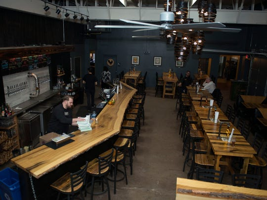 The taproom of the Bhramari Brewhouse located at 101 S. Lexington Ave just behind the Orange Peel.