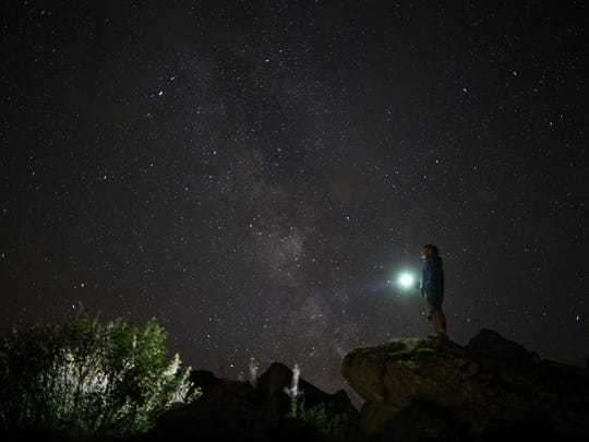 A photographer prepares to take pictures of the annual Perseid meteor shower in the village of Crissolo, near Cuneo, in the Monviso Alps region of northern Italy, on August 13, 2015. The Perseid meteor shower occurs every year when the Earth passes through the cloud of debris left by Comet Swift-Tuttle.