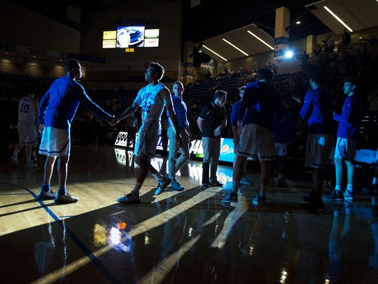 UNCA's Dwayne Sutton is introduced in the starting lineup before a game against Charleston Southern Wednesday at Kimmel Arena.