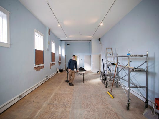 ARTxFM technical director Sean Selby shows off an adjacent space to the WXOX radio studio that is being developed for future exhibits and possibly live shows. 2/4/16