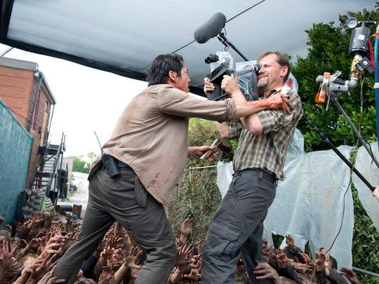 """Steven Yeun as Glenn in a scene from season 6 of ''The Walking Dead."""""""