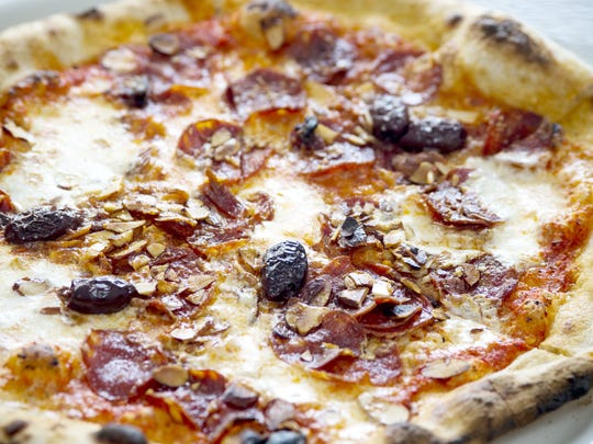 Pizza and a beer is rarely done as well as at Craft 64.The Spain pizza is one of chef Horacio Lachos Hernandez's original creations.
