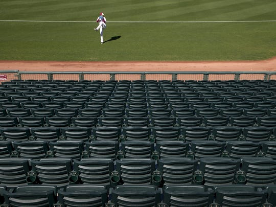 New seats, February 11, 2016, at Surprise Stadium, 15930 N. Bullard Ave, Surprise, Arizona. Warming up on the field is a member of the Nexen Heroes, a professional baseball team from South Korea.