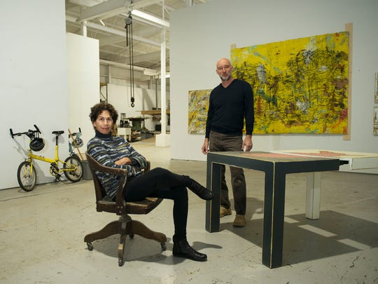 Artists Randy Shull, right, and Hedy Fischer stop for
