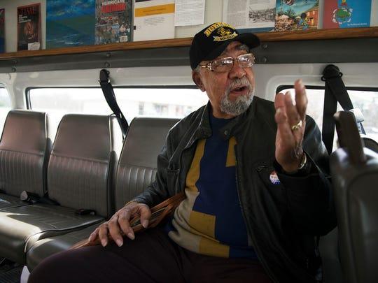 Cliff Cotton, grandson of Burton Street builder E.W. Pearson, rides the Hood Huggers bus driven by founder DeWayne Barton on a tour through West Asheville.