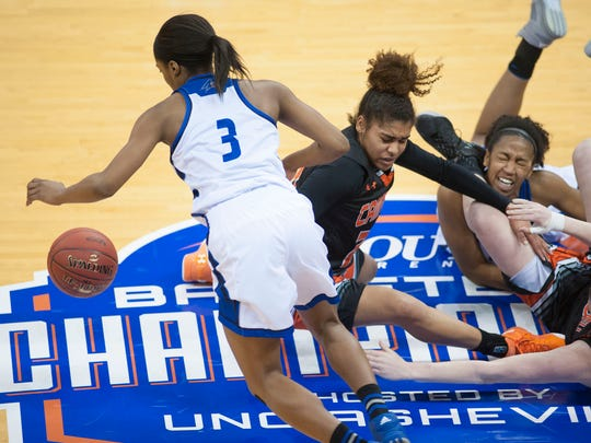 UNCA's Chatori Major dives of r loose ball against Jessica Pone of Campbell in the second period time out while battling Campbell University Friday afternoon during Big South Conference Tournament play at Kimmel Arena.