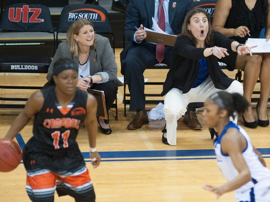 UNCA head coach Brenda Mock Kirkpatrick instructs her team during a second period time out while battling Campbell University Friday afternoon during Big South Conference Tournament play at Kimmel Arena.