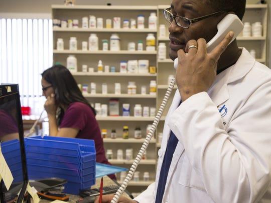 Dr. Lucas Nyabero fills prescriptions, February 29,