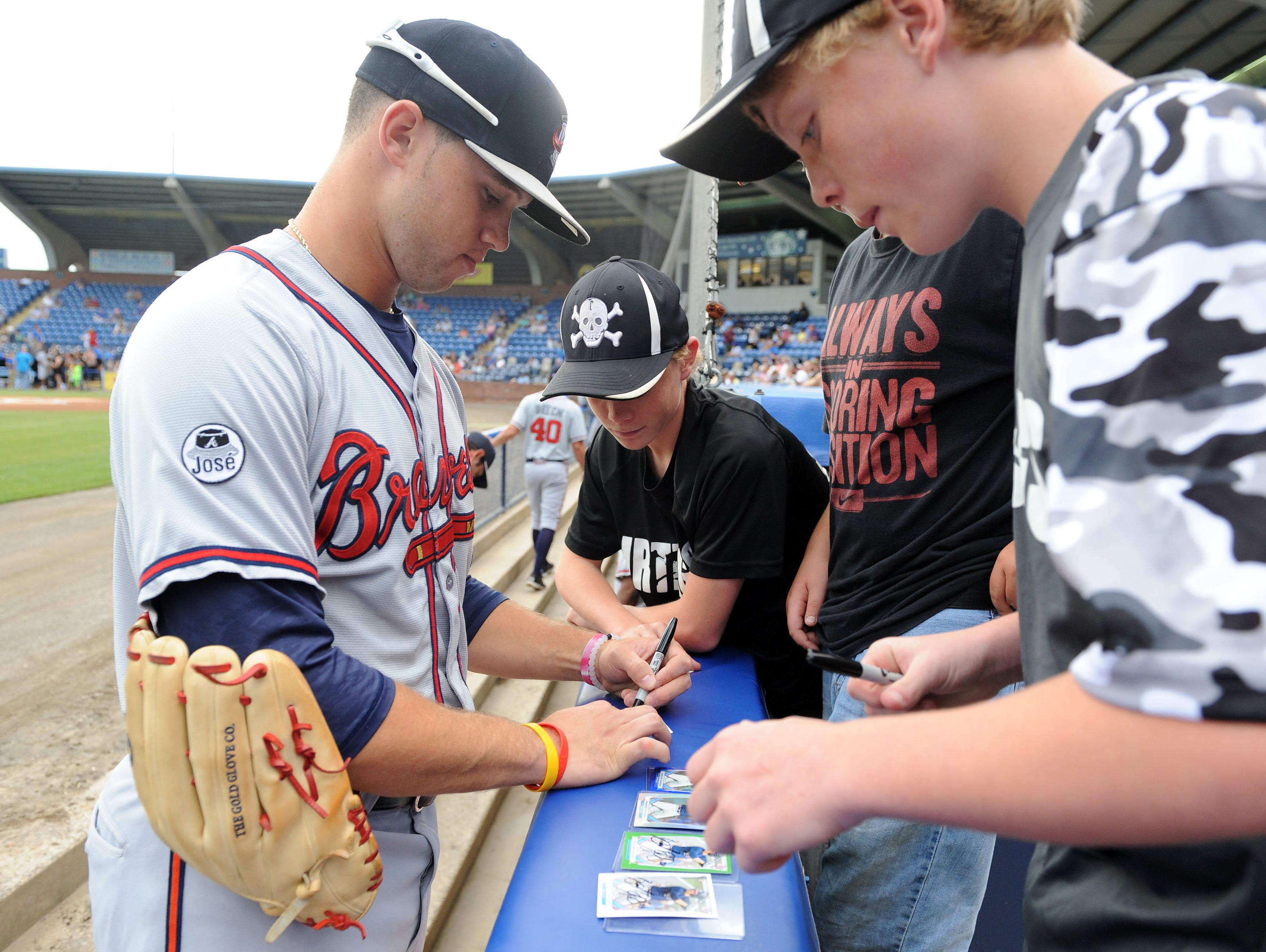 Braxton Davidson signs autographs before a game at Asheville's McCormick Field in 2015.