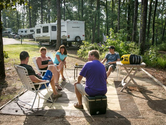 Campers, from left, Chris Davis, Ginger Davis, Liz Van Dine, Dennis Van Dine and Jacob Van Dine relax at their campsite at South Toledo Bend State Park.