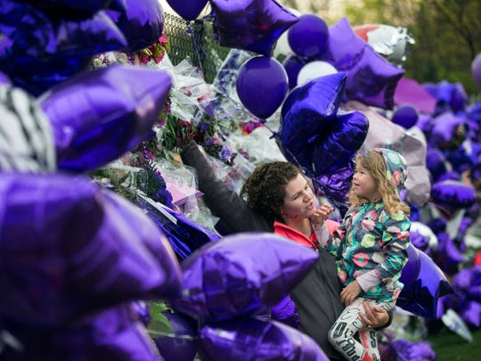 Joy Meuleners holds her niece Keira Abeln at a memorial