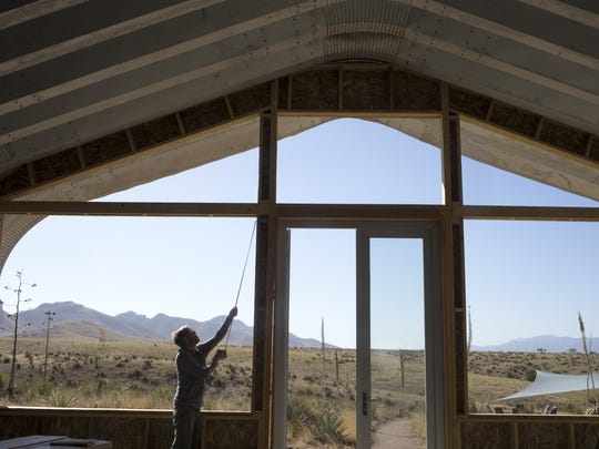 James Callahan measures for a window frame, April 29, at Rune Wines, 3969 Highway 82, Sonoita, Arizona.