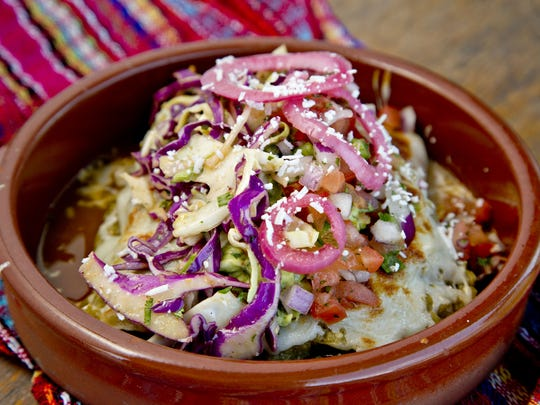 Fill up two street tacos beginning with fillings like roasted tomatillo chicken, guajillo-braised short ribs, the lunch time-only braised bison, or even sauteed spinach and mushroom.