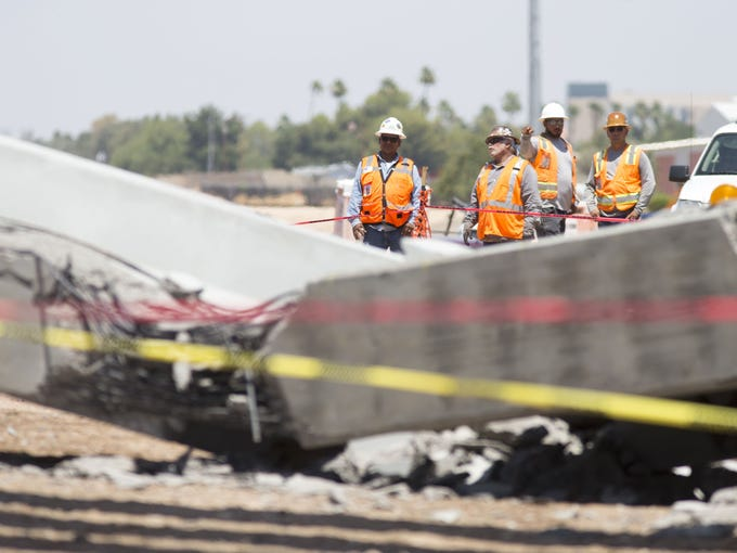 The scene of a girder collapse on an overpass construction