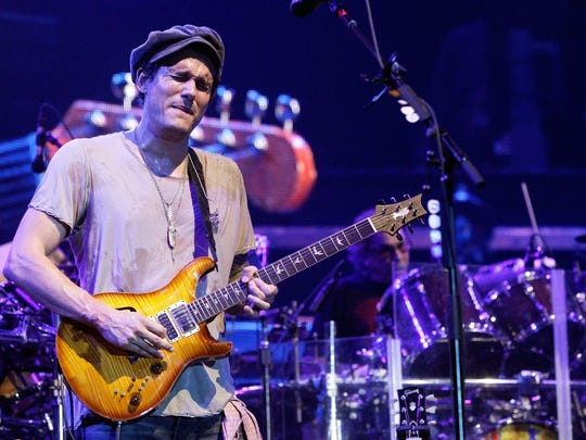 John Mayer, left, performs at the Bonnaroo Music and Arts Festival on Sunday, June 12 in Manchester, Tenn.