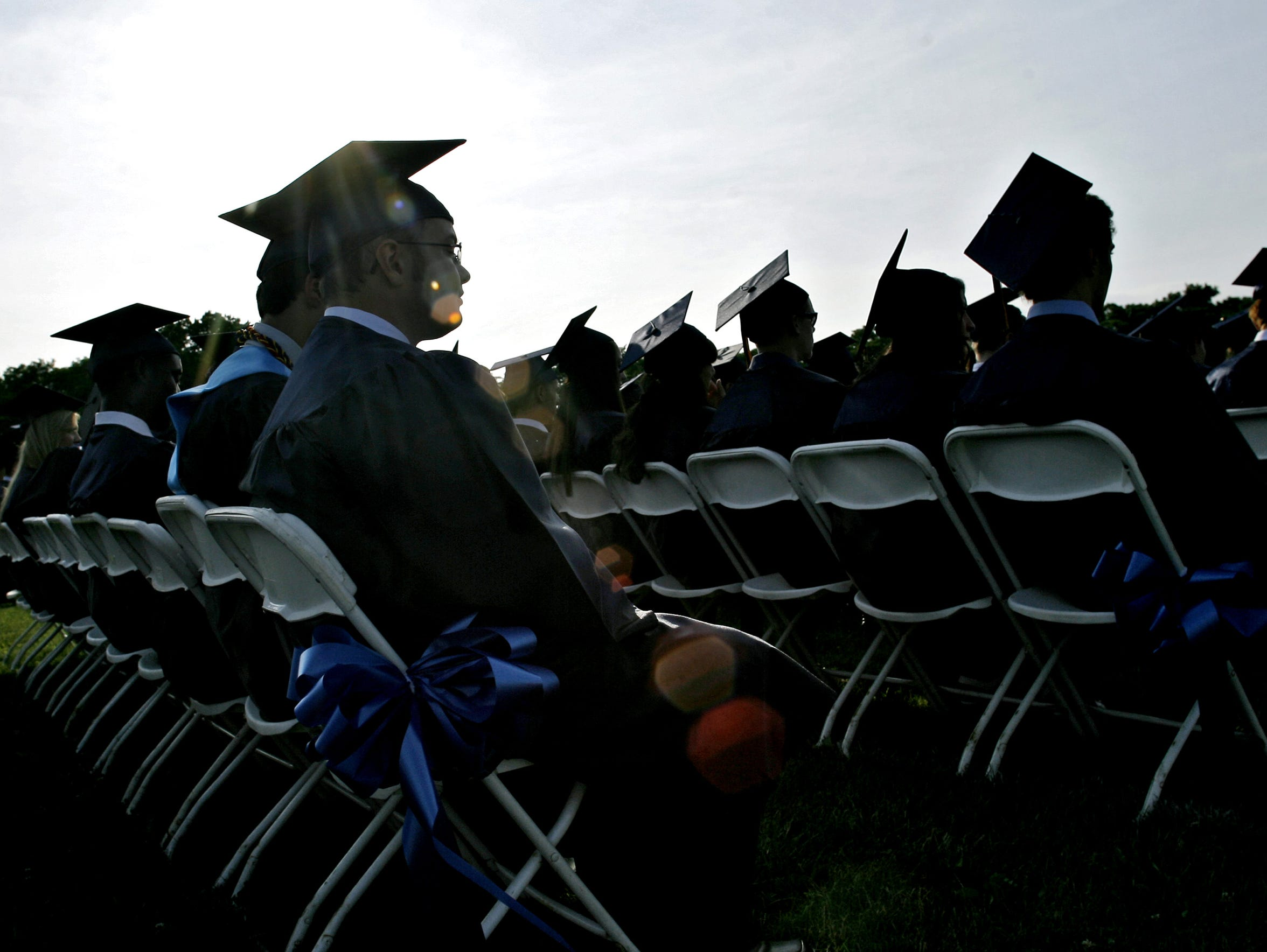 Children from one Marlboro neighborhood have grown up to have an average household income of $86,000 a year, nearly twice the U.S. average. Photo of Marlboro High School graduation by Mike McLaughlin/Special to the Press