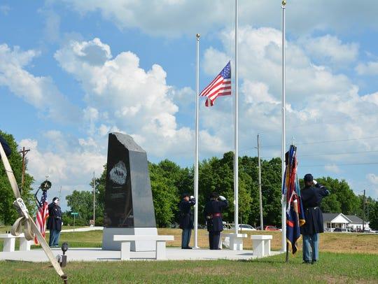 A Civil War color guard salutes the U.S. flag during