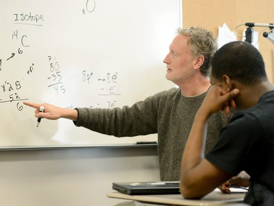 Science teacher Mark Meiri works a student in this file photo from earlier this year.