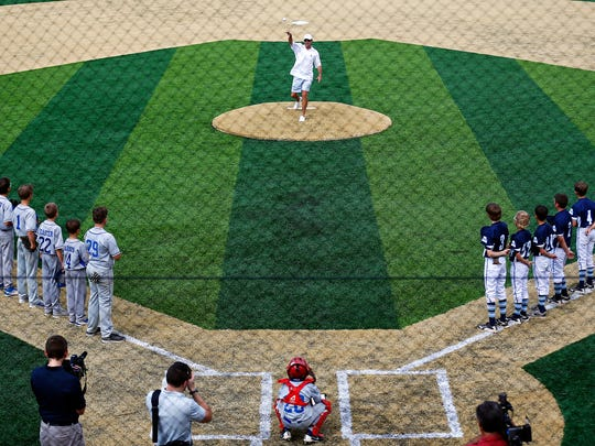 Former Chicago Cubs player Bobby Dernier throws out the first pitch before a short exhibition Little League game during the ribbon-cutting ceremony of the Ballparks of America complex in Branson, Mo. on July 7, 2016.