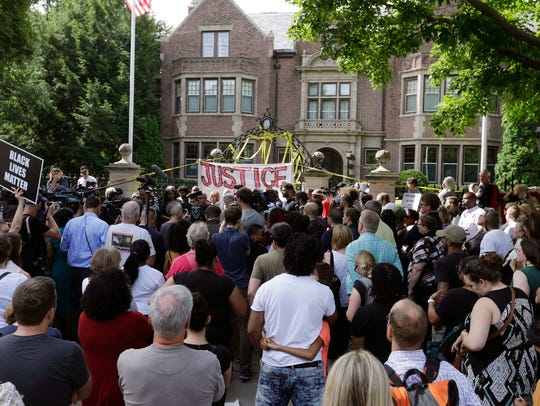 Protesters gather outside the governor's residence