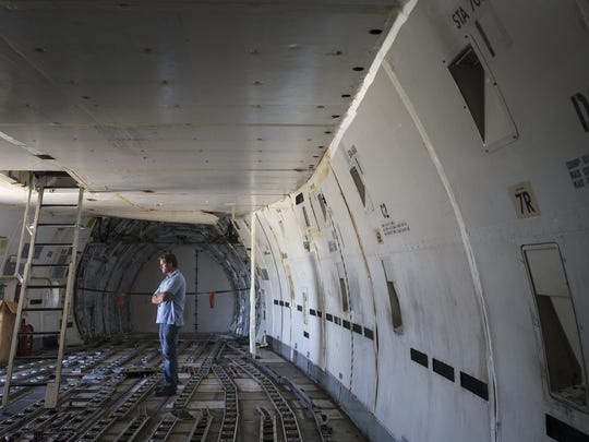 Parrish Traweek (Pinal County Airport Coordinator) stands in the cargo area of a Logistic Air decommissioned 747, June 22, 2016, at Pinal Airpark, Marana, Arizona.