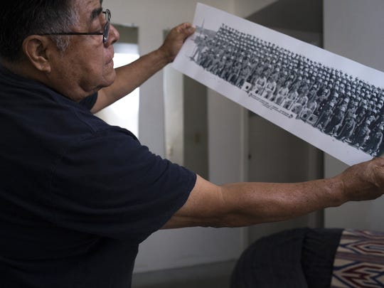 Joe Sorrelman holds up a photo of his Marine Corps