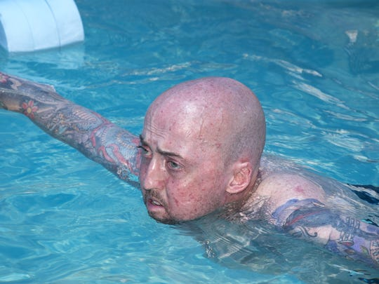 Phoenix Police Officer Ben Denham works, June 13, 2016, during aquatic therapy at the Banner Thunderbird Outpatient Treatment Center, 5555 West Thunderbird Road, Glendale, Arizona.