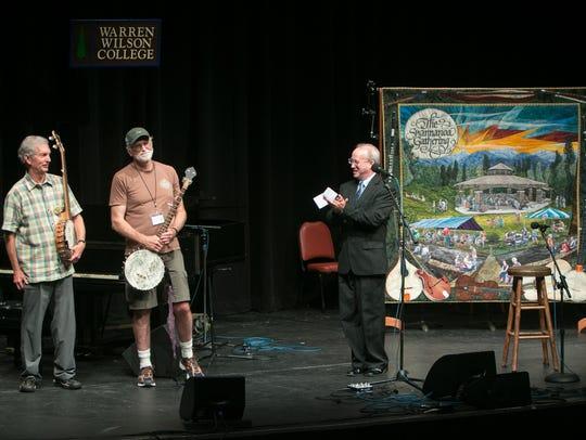 Scott McKinney, right, presents Doug Orr (far left)