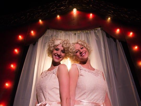 Sisters Nicole and Ashley Dziurzynski prepare for a