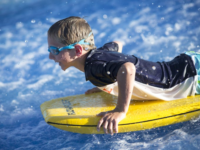 Colby Wolfe (8) enjoys his ride on the FlowRider, August