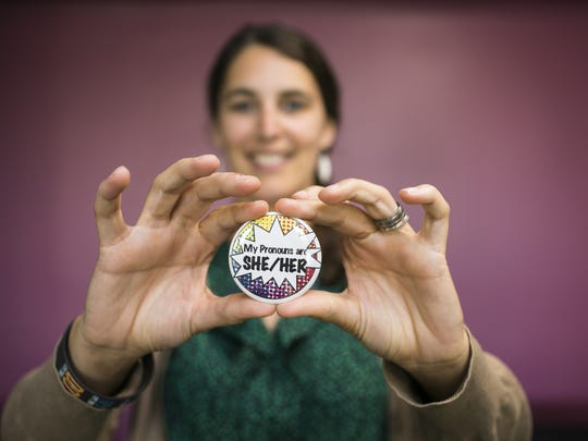 Associate Director Maggie Melvin of the Women and Gender Center at Champlain College shows off one of hundreds of pins distributed to students, on Monday, August 29, 2016.
